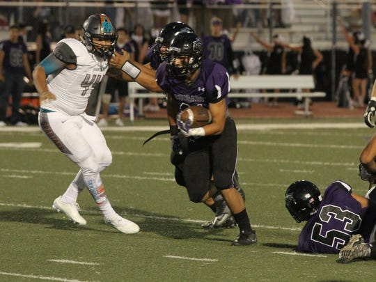 Franklin running back Seth Dominguez charges down field
