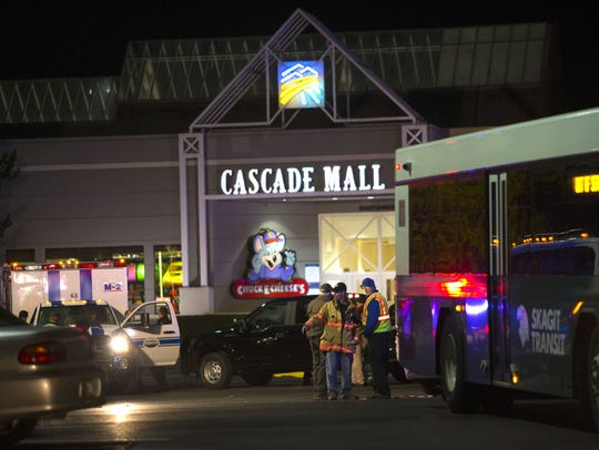Police attend the Cascade Mall after four women died
