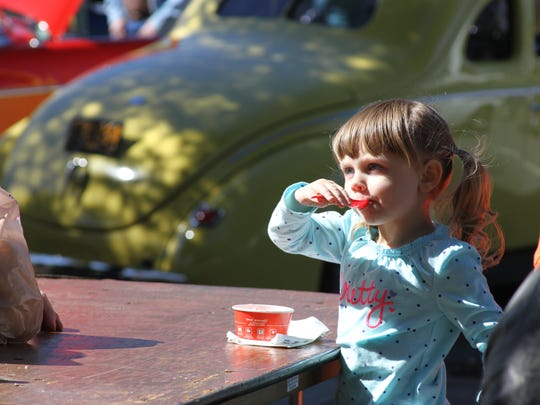 Julianna Rutledge of Honea Path enjoys ice cream at the Standpipe Festival in Belton.
