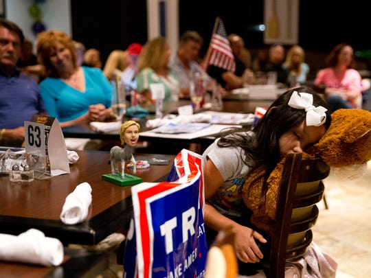 Alexiss Catania, 8, falls asleep while watching the first presidential debate at ROW Seafood by Capt. Brien and Crew restaurant Monday, September 26, 2016 in Naples.