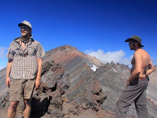 Two climbers stop at the false summit of Diamond Peak