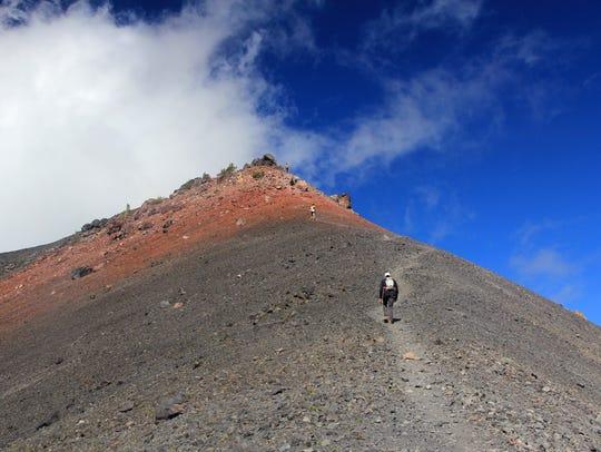 Tyler Dodds makes his way toward the summit of Diamond