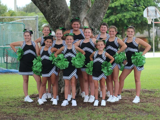 The Hobe Sound Ravens Middle School Cheer Squad poses for a photo before taking the field to cheer on the home team.