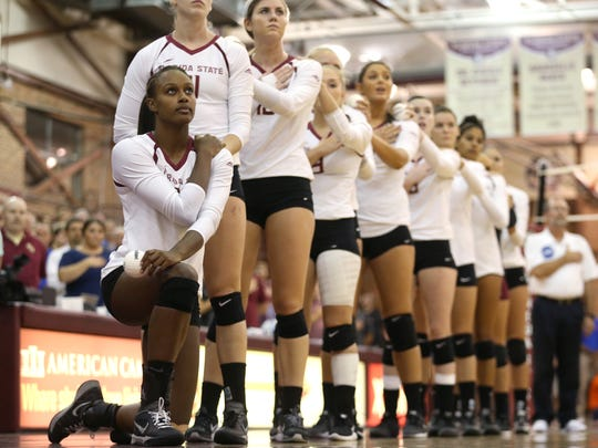 FSU's Mara Green kneels in protest during the national anthem before their match against Florida at the Bobby Tully Gymnasium Wednesday Sept. 14, 2016.