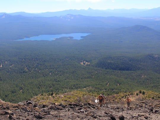 Climbers head up Diamond Peak, with Summit Lake in