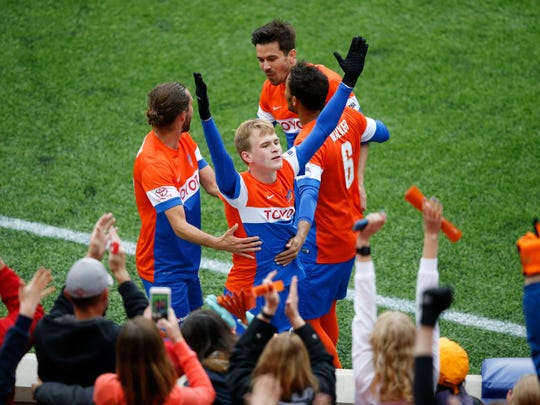 FC Cincinnati midfielder Jimmy McLaughlin (20) blows a kiss to the crowd after scoring in the first half during the USL soccer game between the Pittsburgh Riverhounds and FC Cincinnati, Saturday, May 14, 2016, at Nippert Stadium in Cincinnati.