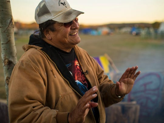 Gerald Iron Shield, 62, of the Standing Rock Sioux talks at the Oceti Sakowin Camp near the Standing Rock reservation Thursday, Sept. 29, 2016.
