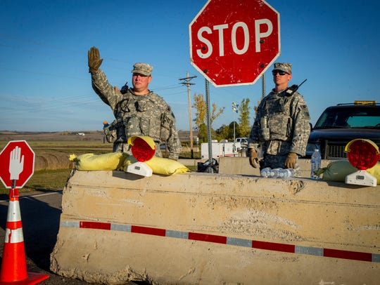 North Dakota National Guardsmen control traffic Sunday,