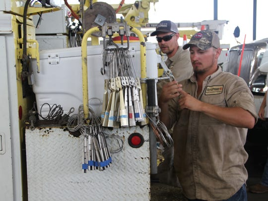 City of Tallahassee Electric Utility linemen load up
