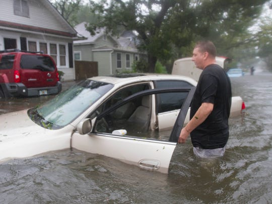 St. Augustine resident, Rob Birch checks on his flooded