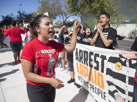 """Viridiana Hernandez protests at the """"Arrest Arpaio Not the People"""" rally held outside Sandra Day O'Connor United States Courthouse on Oct. 11, 2016."""