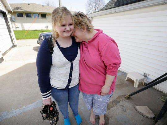 Denise Kirchner hugs her daughter Madison while talking