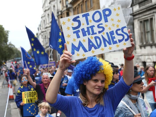 A woman with an anti-Brexit placard joins a March for Europe protest against the Brexit vote in London on Sept 3, 2016.