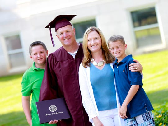 Dennis Wiggins poses with wife, Jill, and their sons Hayden (far left) and Caleb Wiggins.