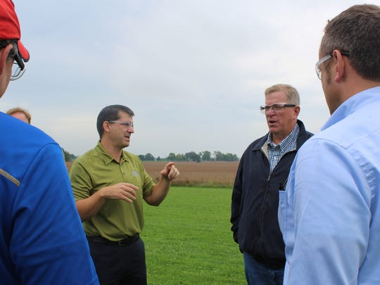 Fox River Valley Ethanol President and General Manager Neal Kemmet (left) answers a question from then Wisconsin Deputy Ag Secretary Jeff Lyon during a Wisconsin Agri-Business Association tour at the ethanol production facility.