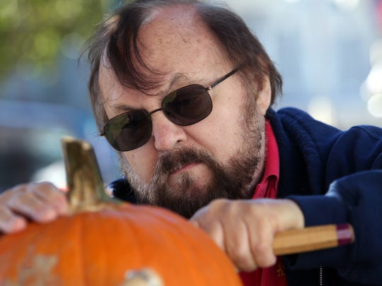 Carver Jerry Cetrulo of Rockaway carves a pumpkin, part of Chester's 33rd Annual Harvest Celebration in Downtown Chester. October 15, 2016, Chester, NJ.