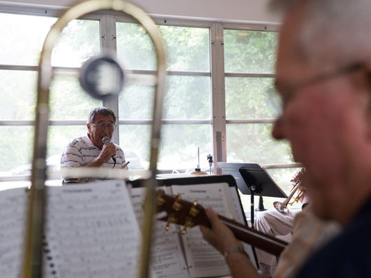 Drummer Frank Michota, 80, sings during a jazz jam session at the home of Jim Gover in Naples, Florida on Tuesday, Oct. 11, 2016. Although members come and go, the group has been meeting every Tuesday for the past eight years. Ray Charles' former band leader, Renald Richard, 91, currently plays the trumpet with the New Orleans-style jazz band.