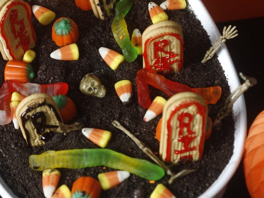 Vienna Fingers are just the right shape to serve as tombstones in this Haunted Graveyard pudding desert.
