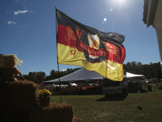 The official Oktoberfest flag flew in the cool breeze