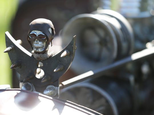 A 1932 Ford 5 window coupe rat rod sports a custom hood ornament at the Broad Ripple Brewpub Hoods & Hops Classic Car Show, held at Opti-Park in Broad Ripple, Sunday October 23rd, 2016.