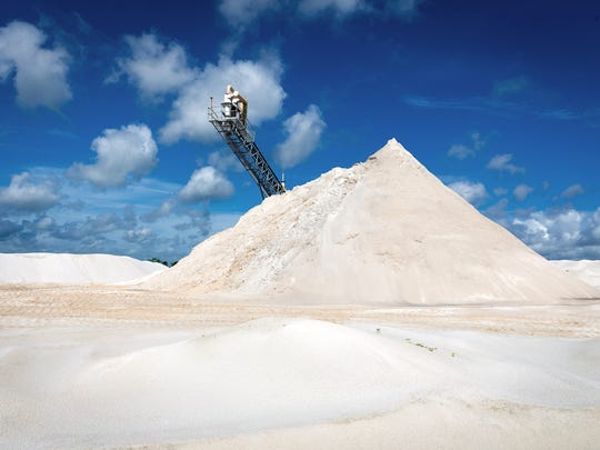 Sand is processed at the Ortona mine in Glades County east of Lake Okeechobee in July.  The mine was the source of sand for Broward County's recent $37 million beach renourishment.