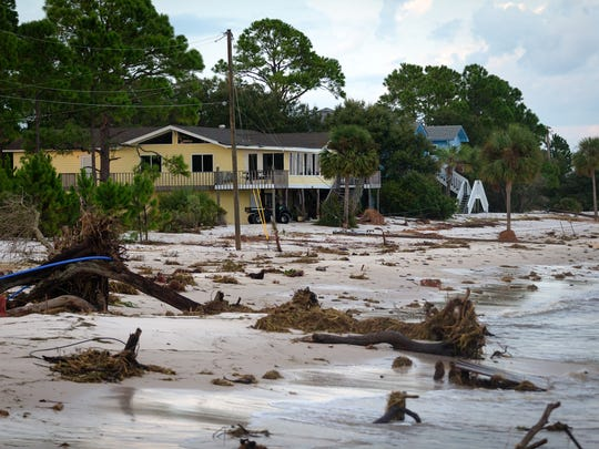 A day after Hurricane Hermine made landfall nearby, Bob Gould's Alligator Point home is seen along a beach where Gulfshore Boulevard once was located. Gould can only reach the property using an all-terrain vehicle because the road once leading to the home has eroded away.  His utilities have been severed by several recent storms.