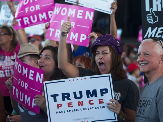 Donald Trump supporters cheer to the media while waiting for Republican presidential nominee Donald Trump to speak during his rally at MIDFLORIDA Credit Union Amphitheater in Tampa, Florida on Monday, Oct. 24, 2016.