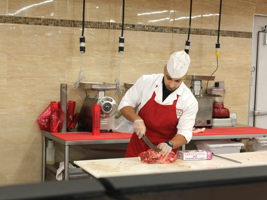 Butcher Peris Rizk works at the halal meat counter