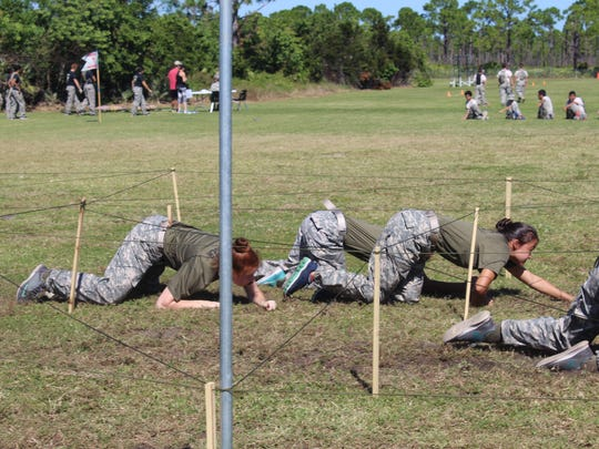 The female team does the 10-yard low crawl, the beginning of the Raider Fitness Challenge.