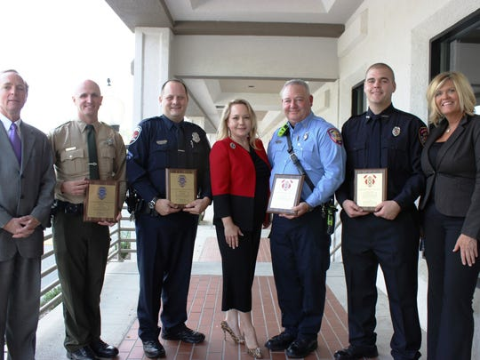 Noon Exchange Club of Murfreesboro honored firefighters and law enforcement officers. From left are Tony Dugger of the Exchange Club, Sheriff's Officer of the Year Deputy Stephen Lewis, Murfreesboro Police Officer of the Year Klint Hill, Exchange Club President Joanne Skidmore, Murfreesboro Firefighter of the Year Engineer Doug Inglish, Rutherford County Fire Rescue Firefighter of the Year Cameron Jacobs and Gayle Passovoy of the Exchange Club.