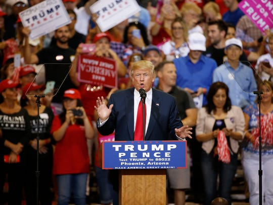 Presidential candidate Donald Trump speaks at the Phoenix