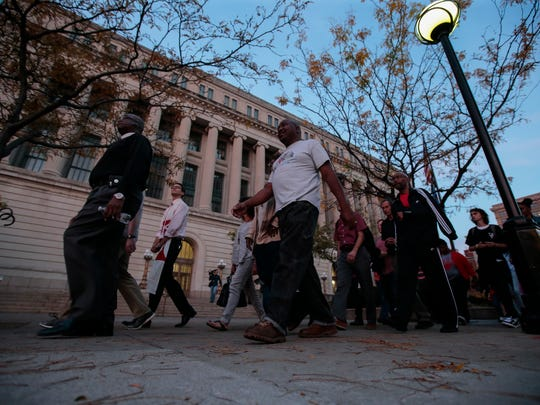 Community members joined by the faith-based community gathered in front of the Hamilton County Courthouse for a walk and time of prayer for Sam DuBose,  Tuesday, Nov. 1, 2016 in Cincinnati. The justice walk was organized by The AMOS Project and Black Lives Matter: Cincinnati.