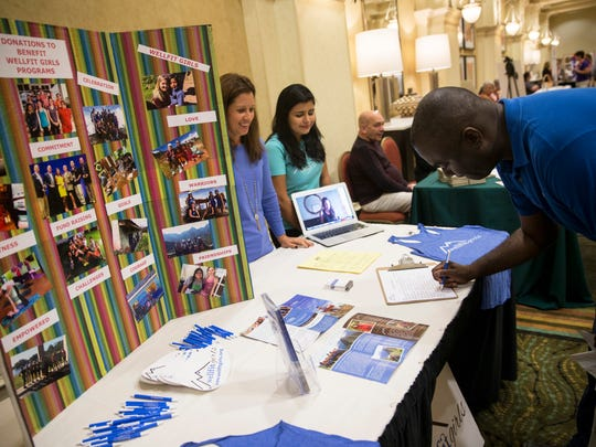 Dorian Ray, right, fills out a volunteer information sheet with Wellfit Girls during the Get Involved Collier! 2016 Volunteer Expo at the Hilton Hotel in Naples on Wednesday, Nov. 2, 2016. Over 50 local nonprofit organizations in Collier County that have volunteer needs attended the event and networked with volunteers.