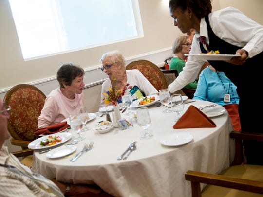 Eileen Moderhack, center left, chats with Jane Drew, center right, during a cooking demonstration by Executive Chef Marion Perez for members of The Carlisle Naples retirement community on Thursday, Nov. 3, 2016. Perez was employed by Donald Trump's private Palm Beach Club, Mar-a-Lago, for five years and was part of a small hospitality crew that launched the club's culinary experiences for members and their guests when the club opened.