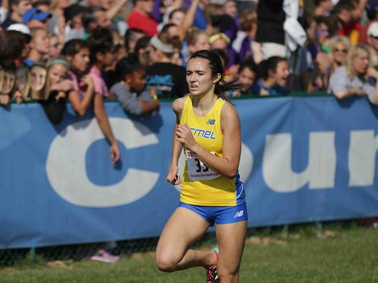 Carmel's Maddie Dalton finished third in the IHSAA cross-country state finals.