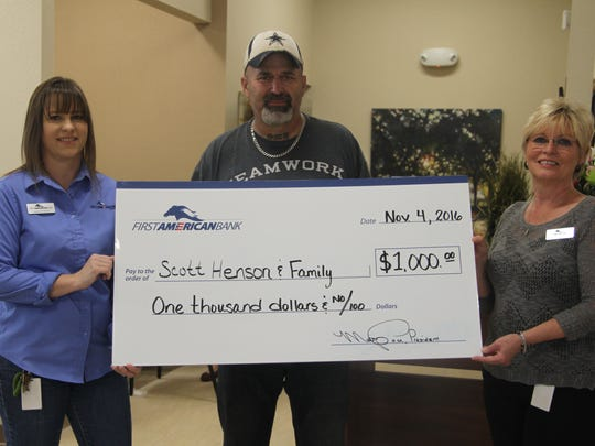 Navy veteran Scott Henson and his family received a $1,000 donation from First American Bank and people in the community.