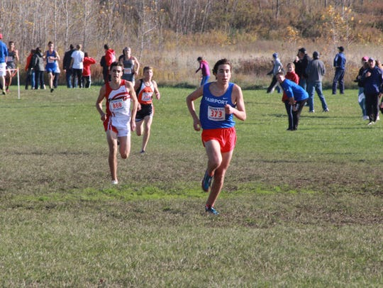 Majd Rouhana leads Penfield's Tyler Senall near the