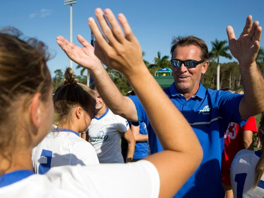 FGCU head coach Jim Blankenship celebrates with his team after defeating Lipscomb, 2-0, in the ASUN Championship Final at the FGCU Soccer Complex Sunday, November 6, 2016 in Estero.