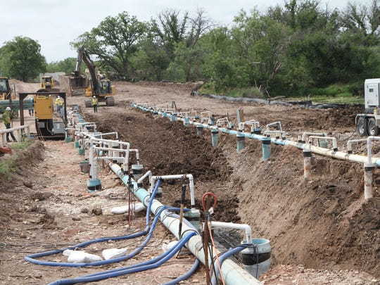 Workers lay the pipeline near the Concho River in 2013