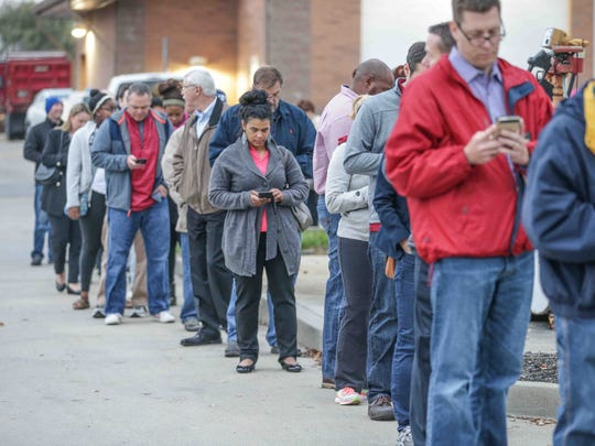 A line of voters winds around the Voters line up at the David Klingensmith Administrative Building, located at the City of Carmel Water Department, to cast their ballots on election day,Tuesday November 8, 2016.