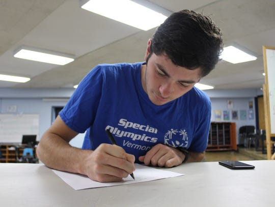 Sam Donnelly completes paperwork on Monday. The 20-year-old