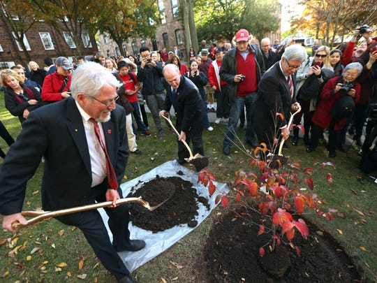 Robert Goodman, l, Executive Dean of Agriculture and Natural Resources, President Robert Barchi and Chancellor Dick Edwards plant a Rutgers 250 All-Star Variety Dogwood tree on the Old Queens lawn in honor of the school celebrating its 250th anniversary. November 10, 2016, New Brunswick, NJ.