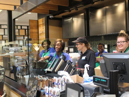 Starbucks employees train to serve coffee at the new