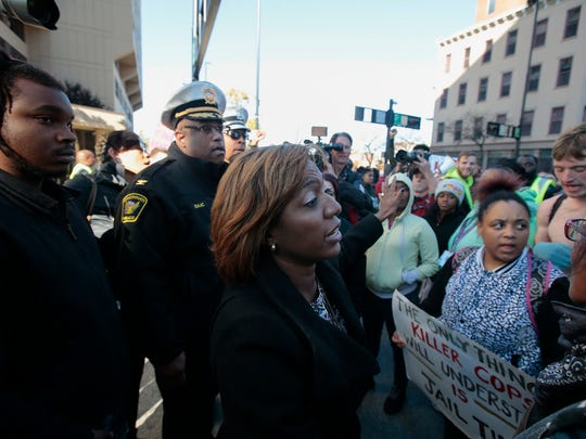 City Councilwoman Yvette Simpson talks to protesters