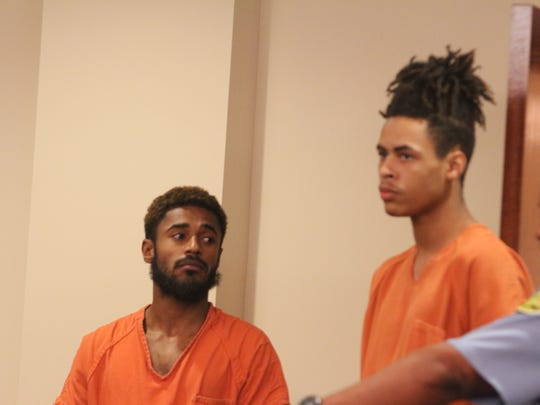 Reginald Pope, left, watches as a bailiff leads in