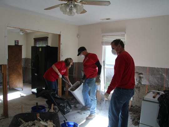 Volunteers from Wells Fargo bank work on cleaning up a Fayetteville, N.C., home that was flooded by Hurricane Matthew.