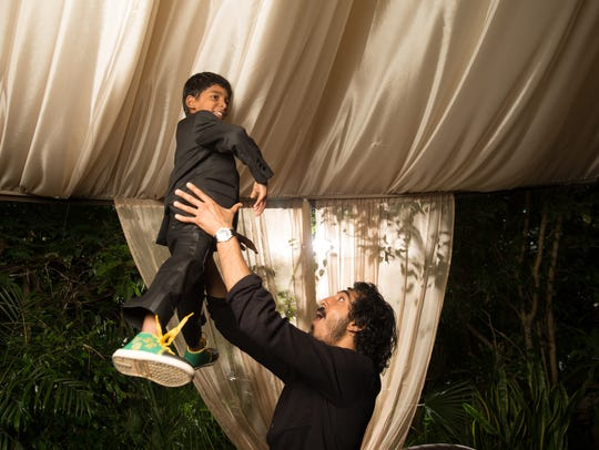 Dev Patel and Sunny Pawar (in air)  are reunited while