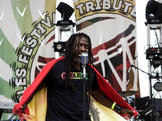 Kooligans frontman Ras Mustafaa performs at the People's Festival in Wilmington over the summer.