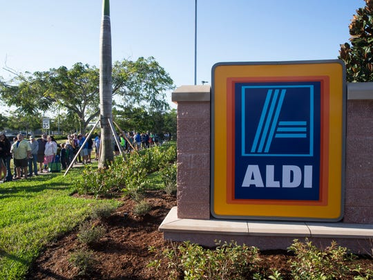 People wait in line before the grand opening of the first ALDI grocery store in Naples on Thursday, Nov. 17, 2016. The first 100 shoppers received a golden ticket, each containing ALDI gift cards ranging from $10-$100.