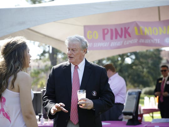 FSU President John Thrasher talks to student Emma McCoy at FSU's Go Pink lemonade stand on Landis Green Thursday, Oct. 1, 2015. The stand was one of many established up around town for the start of breast cancer awareness month.